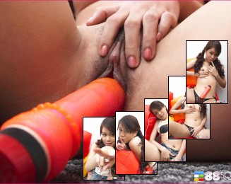Amelia Luv plays with red dildo